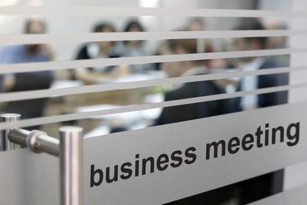 Glass door labelled business meeting